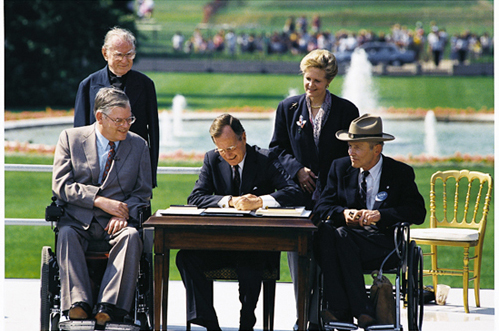 Signing the ADA into law