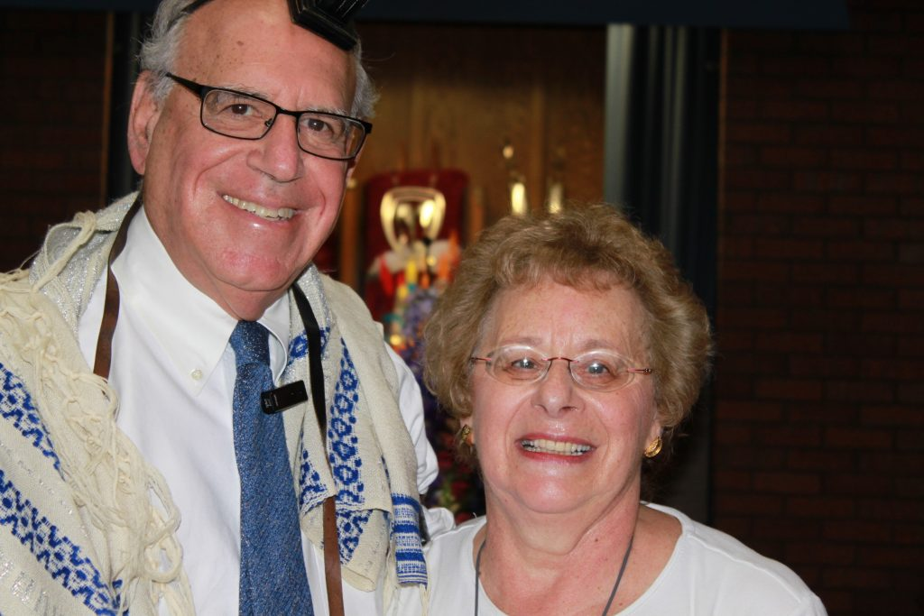 Working together, Ruth was able to hear the blessings uttered by Rabbi Sherman