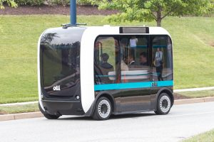 Olli is a rectangular shuttle with rounded edges, designed to look friendly. Photo Credit: Local Motors